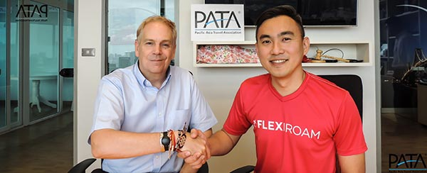 Picture: L/R: Dr. Mario Hardy, CEO, PATA and Nicholas Yeap, VP, Sales & Marketing, Flexiroam Limited