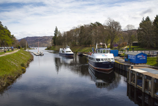 Cruise boats on the Caledonian Canal at Fort Augustus where it joins Loch Ness. Credit VisitScotland / Kenny Lam.