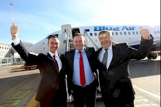 LJLA's CEO Andrew Cornish (centre) celebrating with Blue Air's Chief Operating Officer Tudor Constantinescu (far left) and CEO Gheorghe Racaru (far right) following the news last month that Blue Air are to make Liverpool John Lennon Airport (LJLA) their newest European base.