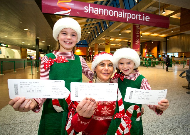 REPRO FREE 131215 Jill Dullea, Ballygarvan Co Cork, with her daughters Maya (8) and Eva (5)  at Check In Shannon Airport all set for the Shannon Airport Ryanair Santa Flghts 2015 on Sunday.Pic Arthur Ellis.