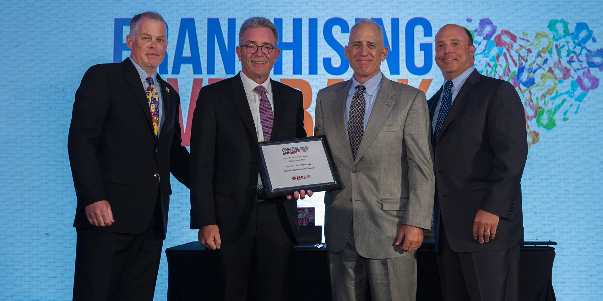 Left to right, Eric Stites, President, Franchise Business Review, Chairman, VetFran Committee, Liam Brown, Marriott International, Colonel John Folsom, Wounded Warriors Family Support, Steve Romaniello, Managing Director, Roark Capital Group, founding sponsor, Franchising Gives Back.